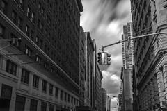 Metropolis ([~Bryan~]) Tags: metropolis city urbanlandscape daytimelongexposure cloudmovement trafficlights road street bw monochrome building nyc newyork manhattan us longexposure time