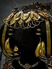 Closeup of Queen Puabi's gold headdress and gold jewelry recovered from the royal cemetery of Ur, Iraq 2550-2450 BCE (mharrsch) Tags: queenpuabi gold lapislazuli carnelian headdress hairribbon wreath earring flower ur sumer mesopotamia iraq artifact ancient 3rdmilleniumbce 26thcenturybce 25thcenturybce pennmuseum philadelphia pennsylvania mharrsch