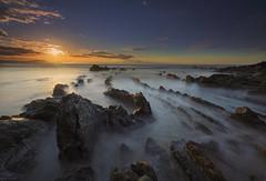 Chase the dragon (explore) (Rafael Díez) Tags: españa paisvasco vizcaya barrika paisaje atardecer sunset sun sol mar agua rocas movimiento filtro rafaeldíez
