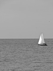 Boat (thelittlepanda) Tags: sea sky white black boat alone relaxing peaceful calm