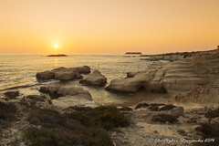 980A0034_ps_L (Christopher S :)) Tags: ocean sunset sea bw orange sun water beautiful blackwhite rocks mothernature mediteranean paphosseacaves 5dmk3 canoneos5dmkiii