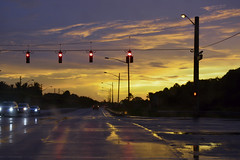 Rainy Afternoon Streets (Emk.photography) Tags: street sunset streets cars wet rain photography nikon cloudy streetlights rainy redlight southflorida nikond3200