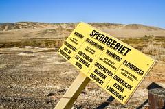 Sperrgebiet warning sign, forbidden diamond area. Trespassers will be prosecuted (jbdodane) Tags: africa sign warning desert mining diamond namibia agatebeach luderitz alamy sperrgebiet day633 namdeb nambed freewheelycom alamy14091119