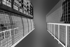 To the Skies II (bw) (Holger Schnell) Tags: china plaza urban blackandwhite white black reflection tower architecture modern facade skyscraper silver beijing structure highrise gateway chaoyang frontage