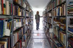 Suspense - EXPLORED (paul indigo) Tags: portrait reading store belgium books racks willemvermandere paulindigo