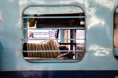 Sleep (jazzyoki) Tags: india window station train sleep transport rail transit peek mumbai waggon