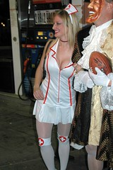Nurse with pantyhose and stockings (hootervillefan) Tags: 2005 nyc white halloween stockings costume high king village mask burger parade thigh nurse cleavage pantyhose