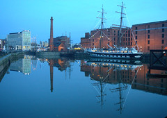 Wet reflections at Liverpool (Tony Worrall) Tags: north country place visit area county attraction open stream capture outside outdoors caught photo shoot shot picture captured liverpool merseyside mersey scouse england northern uk update location tour welovethenorth northwest unitedkingdom docks ship reflection reflections wet wetreflection blue water walkway waterway masts boat