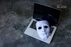Anonymous mask to hide identity on computer laptop - internet criminal and cyber security threat concept (shadowbilgisayar) Tags: mask hacker computer network anonymous attack white background black identity hacking internet theft people business man technology web information danger laptop data security crime code criminal password thief steal symbol protection dark robber fraud card communication damage breach credit cyber banking illegal concept safety notebook pc online virus spy mysterious thailand
