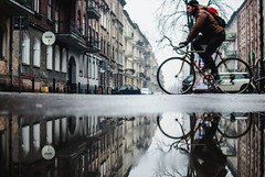 Man on bike. (ewitsoe) Tags: reflection bike nikon d80 35mm street city urban cityscape movement bicycle man ride rideon puddle double winter morning day hipster erikwitsoe ewitsoe