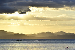 fisherman on sunset (prinz59prince) Tags: sunset silouthe boad fisherman sun clouds golden light blue yellow siena shadow sea ocan shore mountains ray