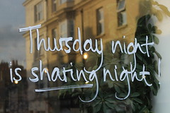 Sharing is caring (chloeharper2) Tags: sharing pub sign written window reflection building yellow golden thelanes brighton uk white photography