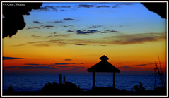 Gazebo (Renal Bhalakia) Tags: ocean sunset sea beach gulfofmexico water silhouette clouds stpetersburg iso800 florida dusk gazebo fl highiso pinellascounty nikond80 nikon18135mm tradewindsresort renalbhalakia tradewindsresorts
