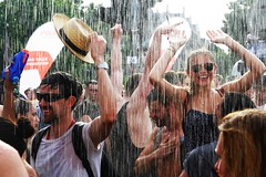 Refreshment (Jungle C) Tags: carnival summer woman berlin men wet water girl sunglasses rain smiling festival fire topv1111 artificial heat tropical cultures brigade refreshment