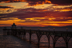 Clevedon Pier Sunset (Simon Giddings) Tags: ocean uk sunset shadow sea summer england sky orange cloud sun sunlight hot water sunshine weather silhouette june dark evening solar pier warm bright cloudy unitedkingdom sunny somerset shade clevedon