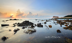 Panoramic Tg. Balau (azrudin) Tags: travel sea sky panorama sun water silhouette stone sunrise still ray slow jetty wave filter malaysia slowshutter johor scapes graduatedfilter gnd09 tgbalau rgnd azrudin azrudinphotography
