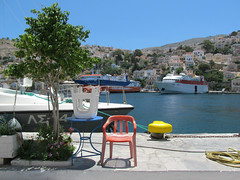 Blue, red, yellow (pefkosmad) Tags: vacation holiday germany island town chairs harbour hellas greece seats greekislands boattrip griechenland scenes symi day