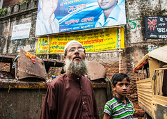 Who are you? (Phg Voyager) Tags: bear street old city color guy walking photography kid outdoor sony dhaka curious bangladesh notsmiling dacca a700 phgvoyager