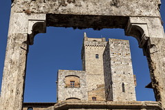 Piazza della Cisterna in San Gimignano (dolorspi) Tags: street old city travel blue sky urban italy color building brick tower castle heritage tourism stone wall architecture town italian ancient san europe european day cityscape village view gimignano outdoor traditional gothic culture nobody landmark tourist medieval historic tuscany toscana picturesque middleages renaissance cultural tuscan torregrossa