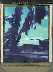 Out To Dry (wetondry) Tags: summer sky landscape polaroid cabin yukon 4x5 largeformat whitehorse 59 graflex speedgraphic peelapart sheetfilm