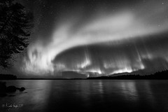 Halloween Auroras (Perukassa) Tags: sky bw lake reflection halloween night finland stars october auroraborealis