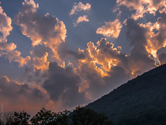 Cloudy Sunset (Sascha Stocker) Tags: blue trees sunset sky orange white yellow clouds ticino nimbus hill cumulus