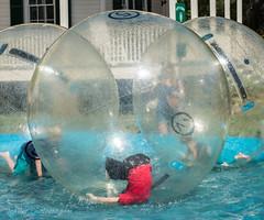 DSC_4670 (felix.graner) Tags: kids water young children pool float flip backflip round ball street streetphotography people