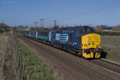 37425 passes Postwick working 2P18 1036 Norwich - Great Yarmouth 15/3/2017 (Paul-Green) Tags: english electric type 3 diesel engine loco locomtive class 37 374 37425 37423 postwick canon 7d mk2 mark ii flickr 2p18 1036 norwich gt great yarmouth passenger service drs direct rail services aga abellio greater anglia outdoors sun sunny morning march 2017 uk gb norfolk railways track field bridge stock