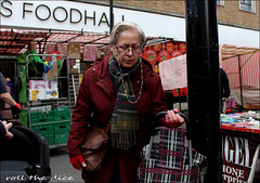 `1920 (roll the dice) Tags: london islington n1 market chapel streetphotography londonist woman fashion shops shopping old sad mad marksspencer people natural unaware unknown portrait candid stranger surreal funny glasses trolley canon tourism scarf weather busy fruit wisdom apples