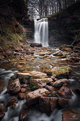 Whispers Of The Forest (MANUELup) Tags: trees leaves sky red forest nature river light rocks fall natural green waterfall longexposure flow naturallight whisper whispers spain woods cantabria naturalpark saja hormigas arbencia