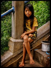 Helps with prayers to Buddha. Oudong. (the jacal) Tags: cambodia cambodge indochina indochine khmer temple oudong mountain girl oudongmountain ancientcapital asia steps prayers buddha mournful smile mournfulsmile
