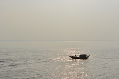 The solitary boat (sanat_das) Tags: westbengal diamondharbour river boat hooghly afternoon d800 50mm