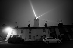 Nightlight (SimonTHGolfer) Tags: blackandwhite lighthouse southwold suffolk houses eastanglia eastcoast fog foggy mist nikon simontalbothurnphotography