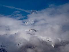 Peaking through the clouds (ZoKë) Tags: visibility weather zermatt clouds peak matterhorn