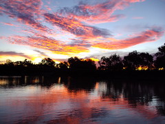 Pink sunset over the Thomson River at Longreach.