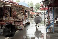 Rainy day in Slavonski Brod. (Originalni Digitalni) Tags: street camera blackandwhite art rain umbrella canon photography eos croatia dslr kisa hrvatska tomislav fotoaparat fotografija digitalni umjetnost 60d slavonskibrod predstavlja kisobran originalni brlog lacic