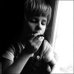 a secret trial (j.p.yef) Tags: boy people bw children cigarette secret smoking sw try nic yef peterfey bestportraitsaoi jpyef