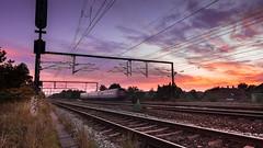 West (Soap Photography) Tags: city longexposure railroad sunset red sky urban orange color colour colors skyscape denmark evening cityscape colours purple pov dramatic rail wideangle rails danmark roskilde