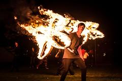 Fire boy - Lismore Lantern Parade 2015 finale. (sbyrnedotcom) Tags: street boy people public yellow night skinny events australia illuminated burning nsw performer gaze flaming lismore lanternparade torchbearer lismorelanternparade