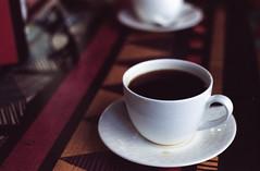 Black Coffee (Himanshu Joshi Bangalore) Tags: film filmcamera ishootfilm kodak portra 400 iso iso400 analog coffee drink surreal negative cosina cosinact1super cosinact1 pentax a50mm 50mm india bangalore
