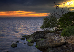Dueling Sunsets (SteveFrazierPhotography.com) Tags: poncedeleon historicalpark puntagorda charlottecounty florida fl charlotteharbor harbor peaceriver rocks sunset horizon waves water reflections stevefrazierphotography landscape seascape scene scenery may summer 2016 clouds beautiful colorful orange yellow rain moss bush hdr autofocus