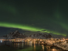 Reine Village by Night (Jyrki Liikanen) Tags: aurora auroraborealis aurorascape aurorastorm village fishingvillage reine norway lofoten reflection reflections waterreflection mountains mountain snowymountains stars starrynight starrysky night nightlight nightcapture nightlandscape nightphotography landscape bay fishingharbour harbour amazing beautiful travel travelling holiday trip happiness