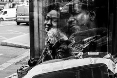 Street - You're not alone (François Escriva) Tags: street streetphotography paris france candid people homeless woan tramp fences denzel whasington bus shelter road cars suitcase black white life poverty bw photo rue noir blanc nb movie poster
