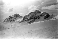 04a3371 32 (ndpa / s. lundeen, archivist) Tags: nick dewolf nickdewolf bw blackwhite photographbynickdewolf film monochrome blackandwhite april 1971 1970s 35mm europe centraleurope switzerland swiss alpine alps graubünden grisons stmoritz easternswitzerland suisse schweitz mountains peaks snow snowy snowcovered skiresort skiarea skislopes skiing landscape sky clouds slopes swissalps
