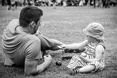 Sharing a moment (Mister GC) Tags: life park street city urban blackandwhite bw girl germany lens deutschland 50mm prime town nikon child shot image candid small young streetphotography photograph icecream sharing nikkor dslr society niedersachsen lowersaxony 18g d3100 mistergc
