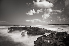 Turbid Waters (Nomadic-Imagery) Tags: longexposure sea bali water monochrome rock clouds indonesia coast rocks rocky highcontrast coastline cascade vapour turbidity blacandwhite turbulent turbid watervapour canoneos5dmark2 bwtenstopndfilter canoneos24105mmlens