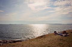 Sunshine for Finnish (marigould) Tags: street sea summer colour hat sunshine finland helsinki nikon sleep north young tan enjoy mm nikkor scandinavia suomenlinna 18105 d7000