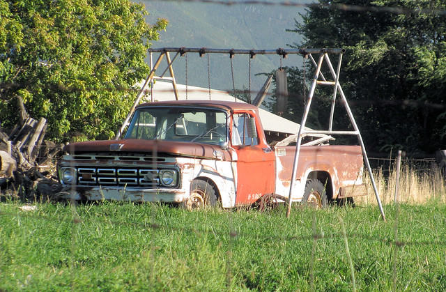old red brown white classic ford abandoned playground rural truck vintage fence rust farm swings rusty pickup pickuptruck farmland swing odd faded pasture forgotten rusted barbedwire vehicle modified fencing swingset 1960s retired oddball barbed 1962 jalopy 1964 beatup junker 1963 beater madeinusa americanmade 2wd oxidized fomoco fencedin f250 worktruck farmtruck outtopasture 34ton oddpanel eyellgeteven