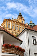 Melk Abbey, Austria (Libra 42) Tags: flowers blue windows red sky white house church abbey yellow canon day partlycloudy eosrebelsl1