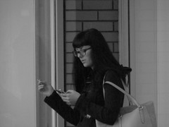 Text And Tab (alexinatempa) Tags: woman girl mobile swansea wales mono glasses ngc cellphone smoking mobilephone smoker citycentre nationalgeographic